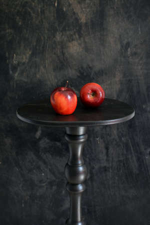 Still life with Two apples on black small table