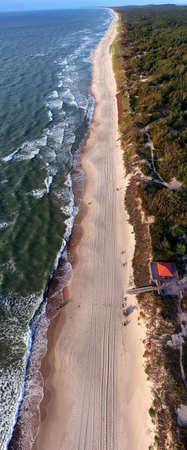 Aerial view over a Baltic Sea shore beach near Nida, Lithuania, vertical pano