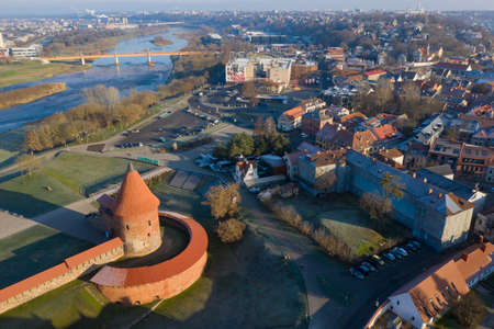 Kaunas castle with tower in autumn and Neris river, Lithuania, aerial Editöryel