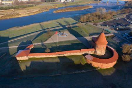 Kaunas castle with tower in autumn and Neris river, Lithuania, aerial view
