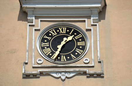 Clock on historical church bell tower wall, Lithuania