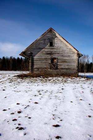 Old wooden historical barn on winter field Stok Fotoğraf