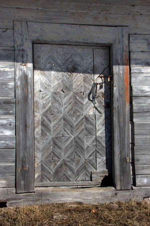 Historical old used wooden ornamental barn door Stok Fotoğraf