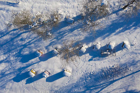 beehives covered with snow in winter, aeriaL view