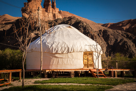 Kazakh yurt on the Silk Way in Kazakhstan green mountains Stock Photo