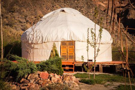 Kazakh yurt on the Silk Way in Kazakhstan green mountains Stock Photo