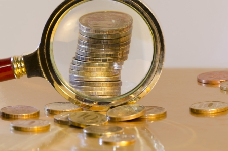 A stack of coins, increased under a magnifying glass photo