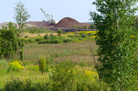 The natural landscape near the dozer and excavator mining operations photo