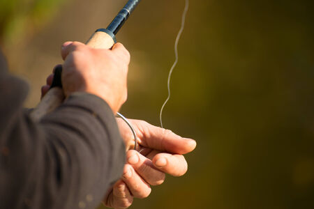 hand line fishing: Spinning in the hands of the angler