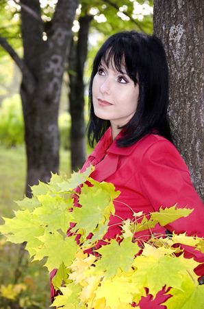 pensiveness: Girl with a bouquet of yellow leaves Archivio Fotografico