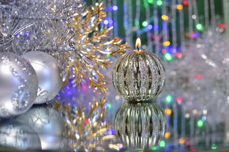 christmas snow: Christmas decorations with candle and silver balls on the mirror. Stock Photo