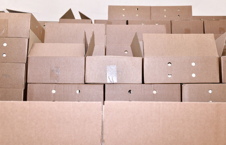 packing boxes: Cardboard packing boxes in a warehouse. Stock Photo
