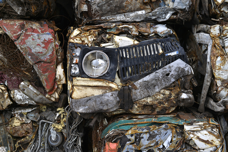 scrapyard: A pile of compressed cars in blocks for processing. Stock Photo