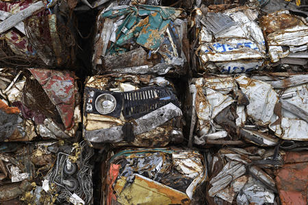 abandoned car: A pile of compressed cars in blocks for processing. Stock Photo