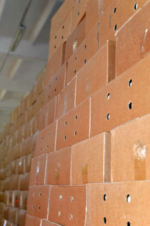 packing boxes: Cardboard packing boxes in a warehouse, background.