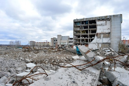 earthquake: Pieces of Metal and Stone are Crumbling from Demolished Building Floors Stock Photo