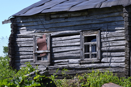 Old abaOld abandoned wooden farmhouse closeup