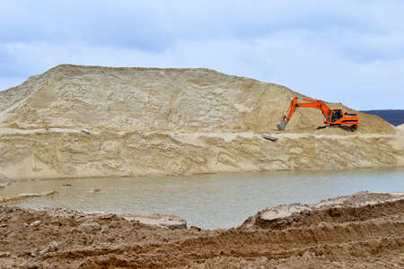 sand quarry: Working digger in a quarry produces sand