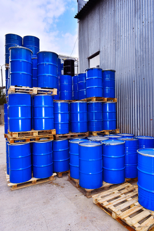 fuel tanks: Blue metal fuel tanks of oil stored at the production site. Stock Photo