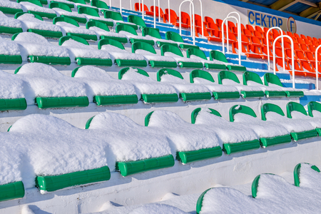 covered fields: Background chairs at stadium , winter Stock Photo