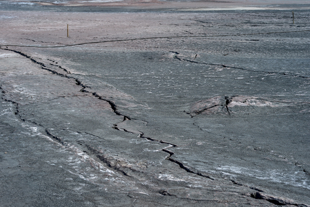 Cracks on the surface of dry land. Stock Photo