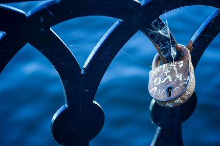 Love lock on the railing of the old bridge close up. Stock Photo