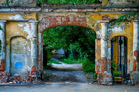 Picturesque old broken brick arch in the town yard.