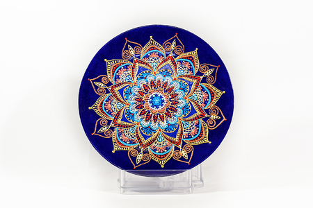 Decorative ceramic dish painted with hands. Art, handmade Stock Photo
