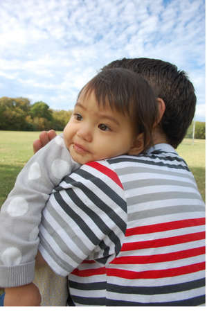 11 year old: Father and his 1.1 year old daughter were in a park for a picnic on his day off. This is his their happy moment.