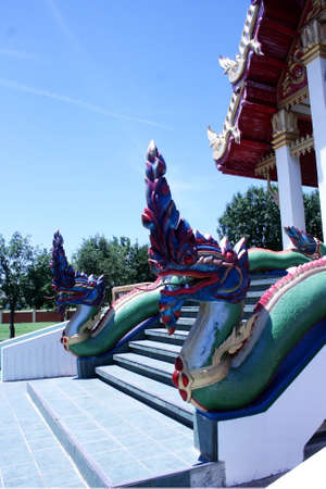 mythical: Naga or sepent is a mythical animal which we usually see in the area of Buddhist temple especially in front of a main chapel. Stock Photo