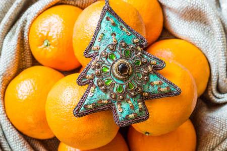 クリスマス ツリーの飾りとオレンジの袋横になっています。 写真素材