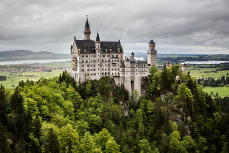 ludwig: Schwangau, Bavaria, Germany - May 19th, 2013: Neuschwanstein Castle - the famous European castle built by King  Ludwig II of Bavaria