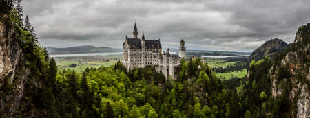 ludwig: Schwangau, Bavaria, Germany - May 19th, 2013: Neuschwanstein Castle - the famous European castle built by King  Ludwig II of Bavaria