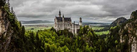 schwangau: Schwangau, Bavaria, Germany - May 19th, 2013: Neuschwanstein Castle - the famous European castle built by King  Ludwig II of Bavaria