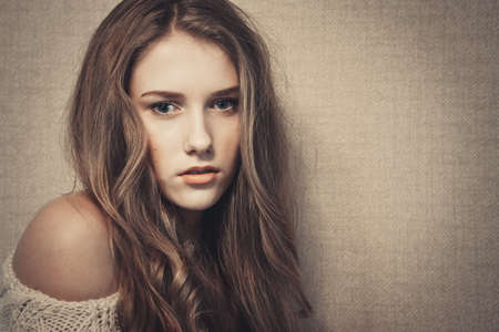 Young beautiful girl looking at camera, dramatic look, art portrait