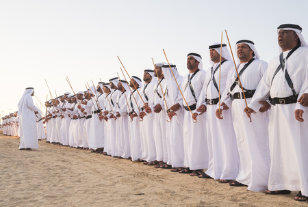 Men perform Yawalah traditional dance  in SHEIKH ZAYED HERITAGE FESTIVAL September 22, 2014 in Abu Dhabi, united arab emirates Editorial