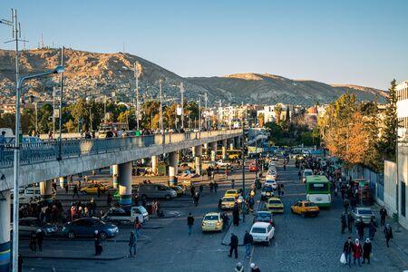 Buss station under Al Jameyah As Soureya bridje in Damascus (Syrian Arab Republic) after war ended in 02.12..2019