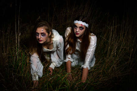 Creepy dead bride at night in a swamp. Bride girls at night. Halloween scene. High quality photo