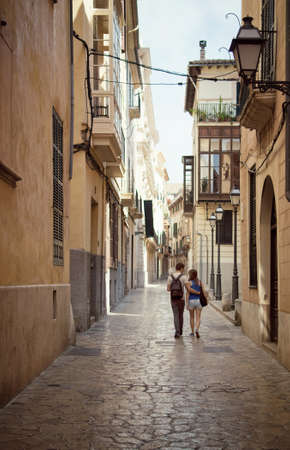 Loving couple walking down the street in Palma de Mallorca, Majorca, Balearic Islands, Spain photo