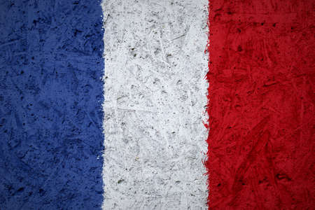 concrete background: Flag of France on the concrete texture