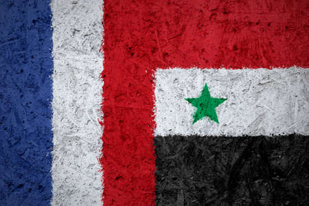 europe closeup: France and Syria flags on the concrete texture