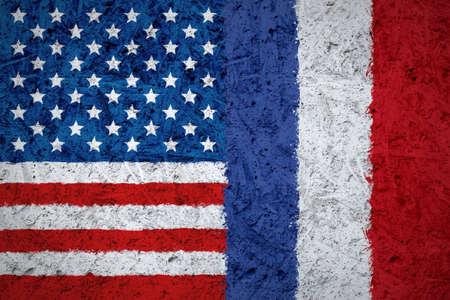 USA and France flags on the concrete texture Фото со стока