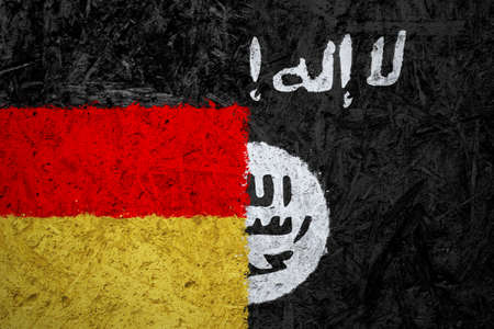 iraq war: Germany and Islamic State of Iraq and the Levant flags on the concrete texture