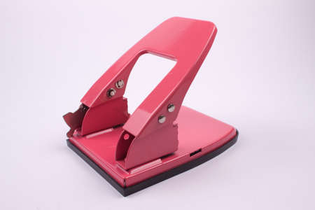 hole puncher: Pink hole puncher isolated on a white background Stock Photo