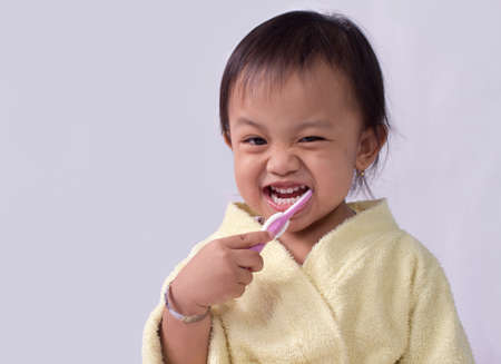 kindergartner: Child girl cleaning teeth with toothbrush