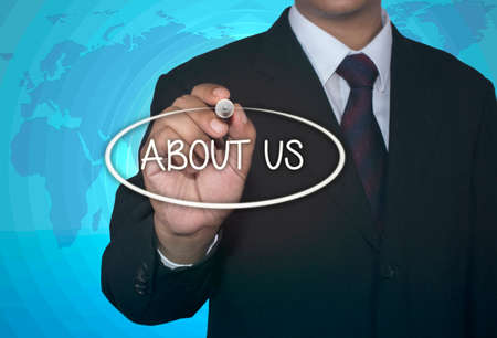 write us: about us businessman write concept