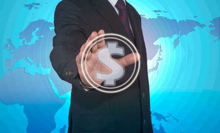pushing button: Businessman pushing button with dollar sign Stock Photo