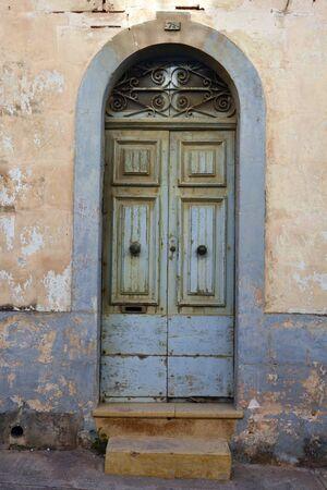 ironwork: Mellieha, Malta - January 27, 2016. Blue wooden door with ironwork on top in Mellieha, Malta. Editorial