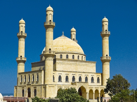 conservative: The huge 1990s Rehime Khanim mosque, built above the grave of sister of the 7th Shiite Imam, is the spiritual heart of conservative Nardaran settlement north of Baku, Azerbaijan. Stock Photo