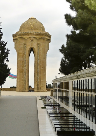 gorbachev: Baku, Azerbaijan - November 21, 2012. Martyrs Lane in Baku, Azerbaijan with a long row of grave memorials to victims of the Red Armys 1990 attack and early martyrs of the Karabakh conflict. Editorial